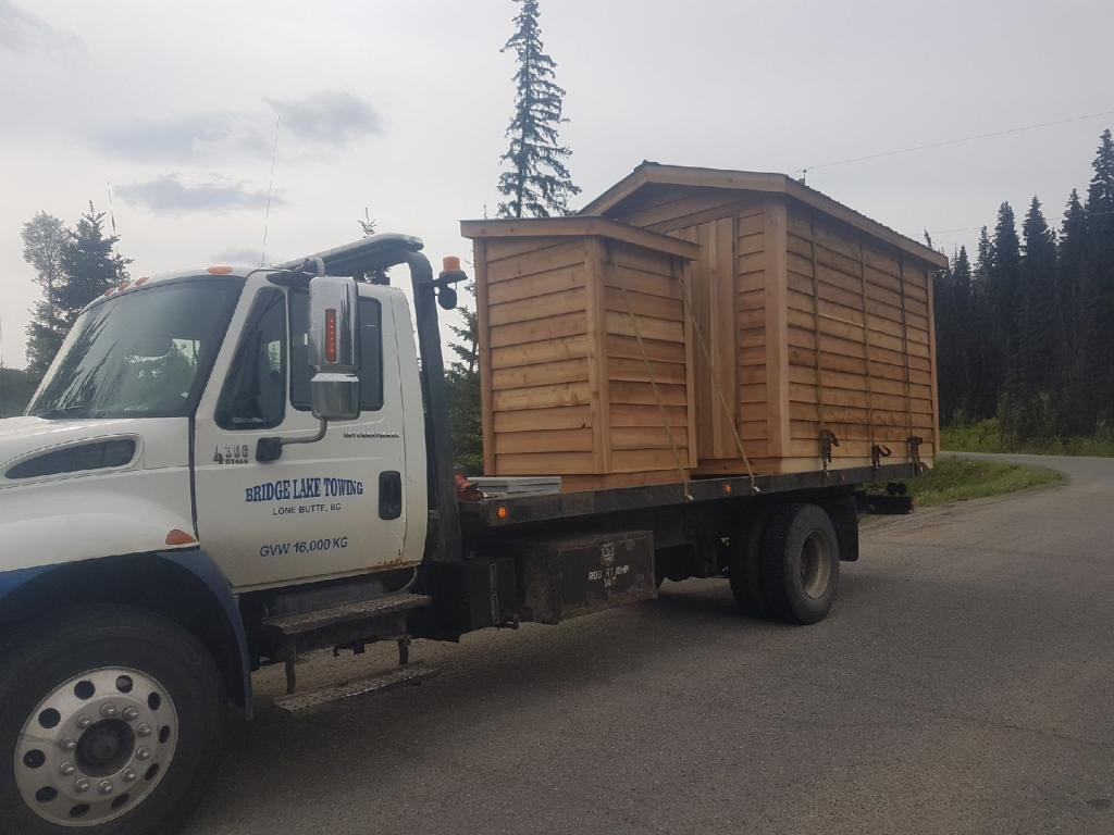wooden house being towed