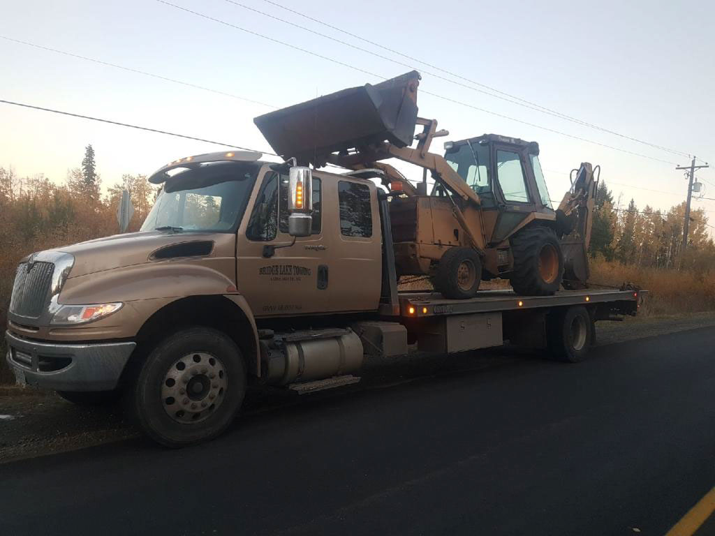 Towing of earth moving machine