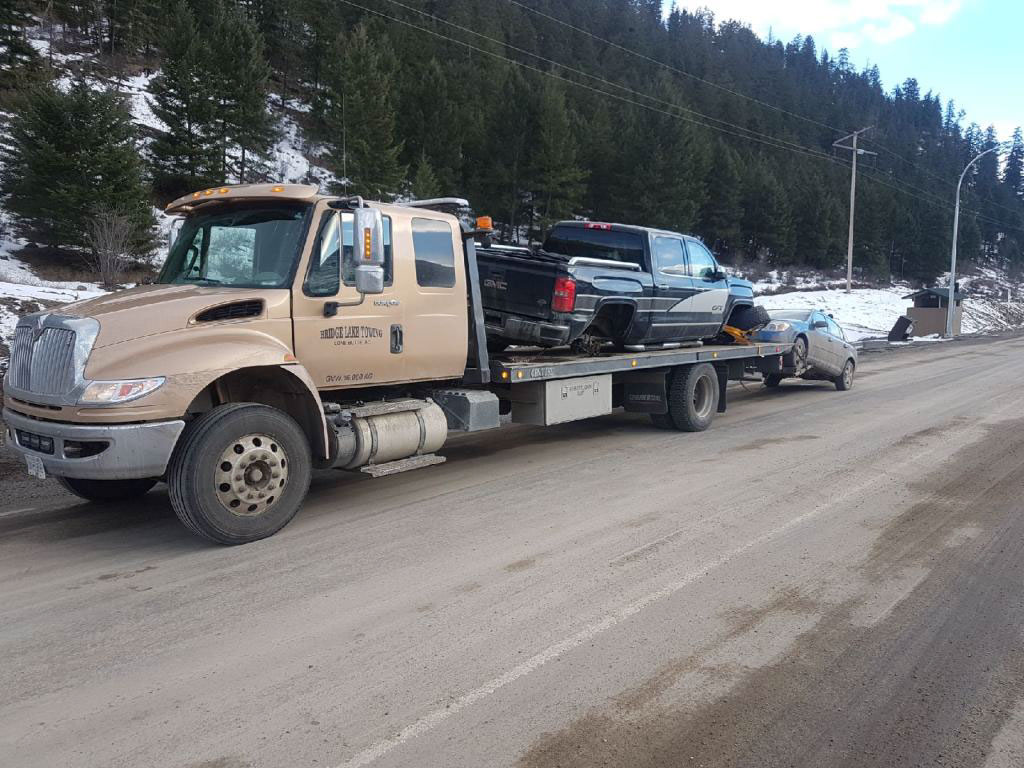 Suzuki truck being towed